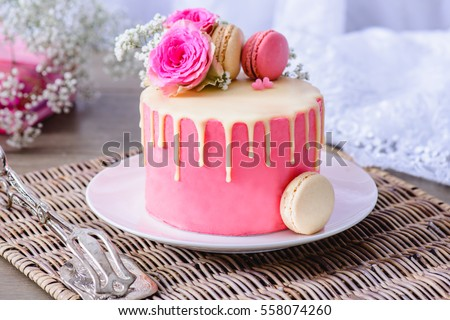 Pink romantic cake decorated with macaroons and flowers for someone special