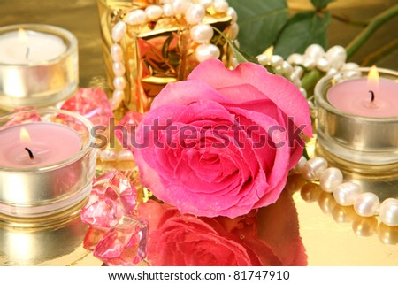 Pink rose and candles