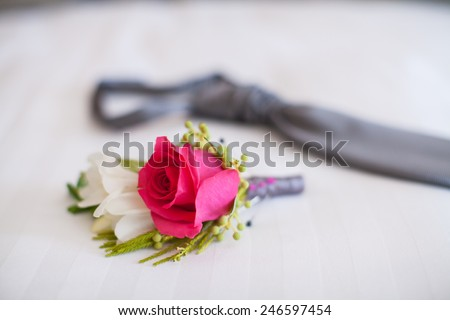 Pink rose boutonniere flower - stock photo