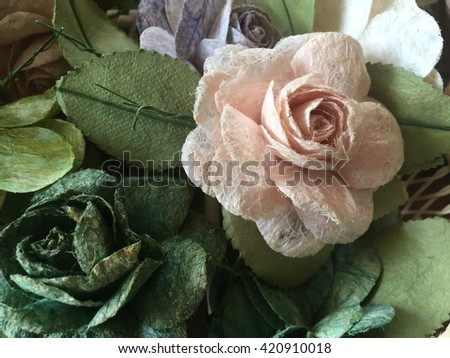 Pink rose flowers in mulberry paper texture with lighting at morning - stock photo