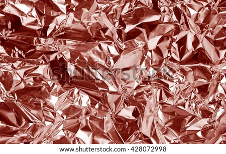 Pink rose gold foil background with shiny crumpled uneven surface for texture and background - stock photo