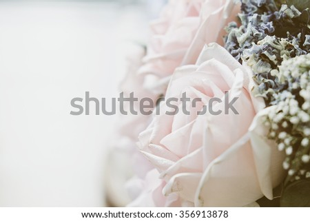 Pink rose in a floral bouquet - stock photo