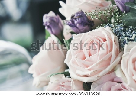 Pink rose in a floral bouquet