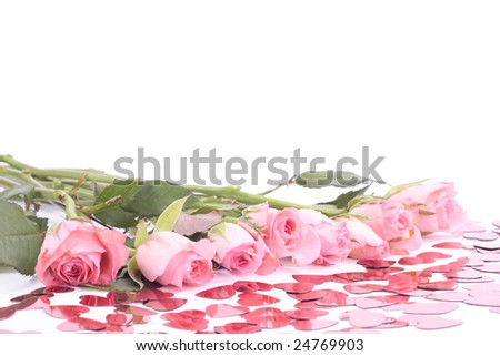 Pink roses and valentine heart shapes on white