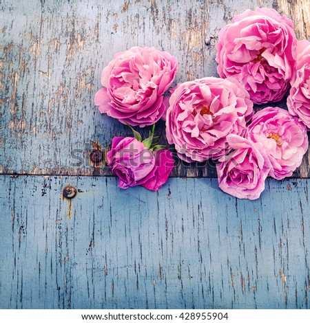 pink roses bouquet on wooden background - stock photo