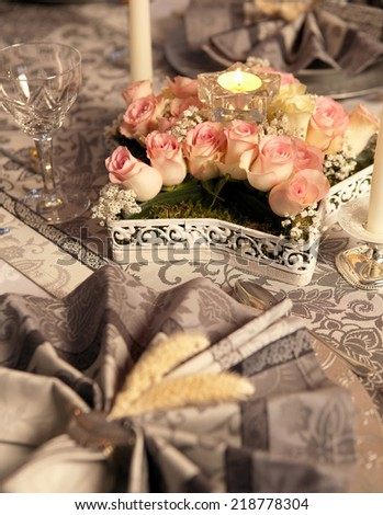 Pink roses flower arrangement on a fancy christmas table - stock photo