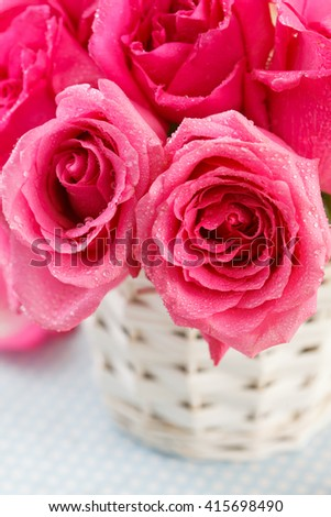 pink roses in the basket - stock photo