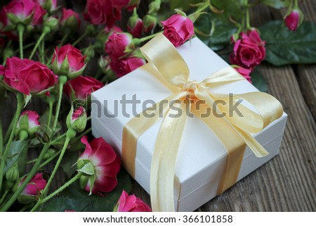 Pink roses on a wooden table, holiday background