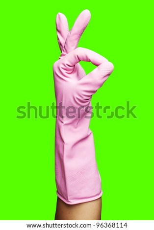 pink rubber gloves gesturing rabbit against a removable chroma key background - stock photo