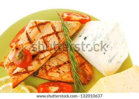 pink salmon and french cheeses on green