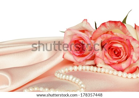 Pink satin and roses on white background - stock photo
