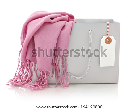Pink scarf in shopping bag with tag isolated on a white background - stock photo