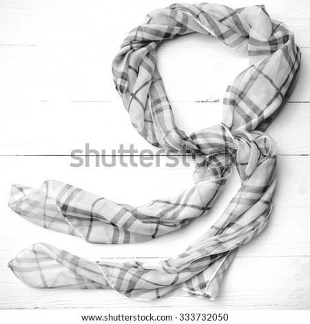 pink scarf over white table black and white color - stock photo