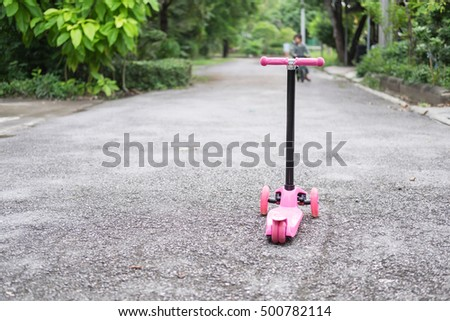Pink scooter on the road