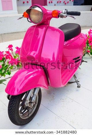 Pink Scooter parked with the pink flowers