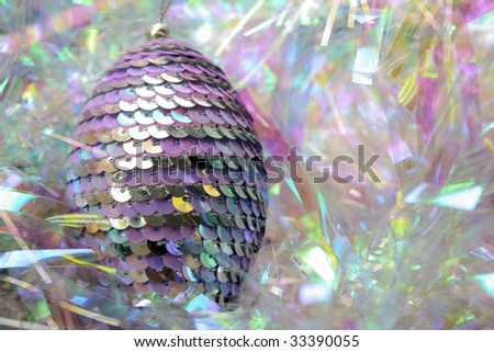 pink sequinned christmas bauble in a tinsel nest - stock photo