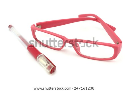 Pink set of pens and glasses on a white background - stock photo