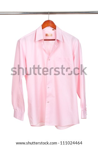 pink shirt on wooden hanger isolated on white - stock photo