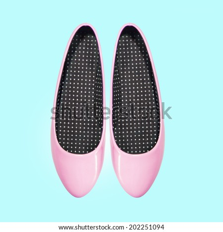 pink shoes on a blue background - stock photo