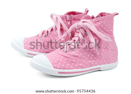 Pink shoes, with dots on a white background.