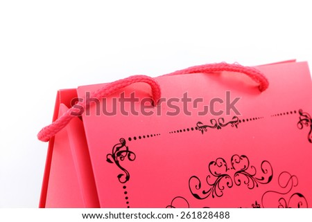 Pink shopping bag with swirl design closeup isolated on white - stock photo