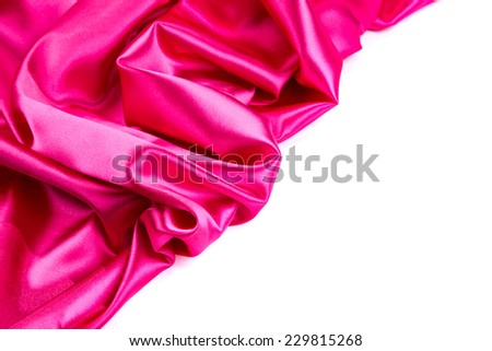 Pink silk drape. Located on a white background.