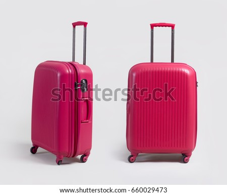 538849843132 Pink small luggage bag side and front view isolated on white