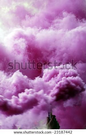 Pink smoke bomb at hand - stock photo