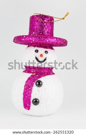 Pink snowman on white background - stock photo