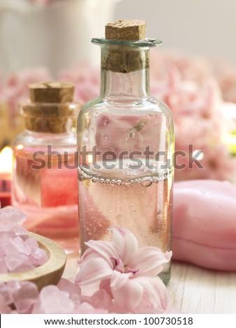 pink spa arrangement with vintage glass bottles - stock photo
