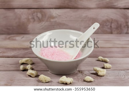 Pink spa salt on a bowl