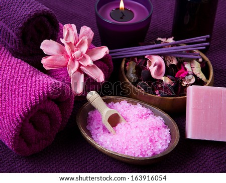 pink Spa tools with candle amd towel - stock photo