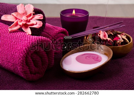 pink Spa tools with candle and towel - stock photo