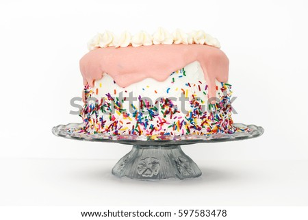 Pink Sprinkles Vanilla Birthday Cake on Vintage Glass Platter with White Background