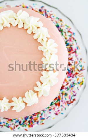 Pink Sprinkles Vanilla Birthday Cake on Vintage Glass Platter with White Background from Overhead