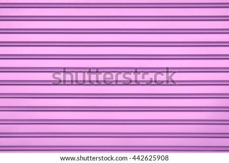 Pink steel door with horizontal lines background. - stock photo