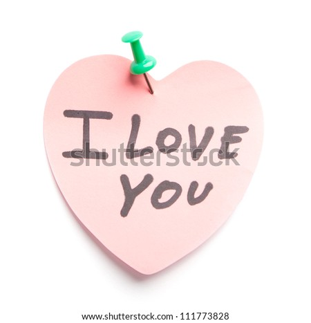 Pink sticky note with written words I love you - stock photo