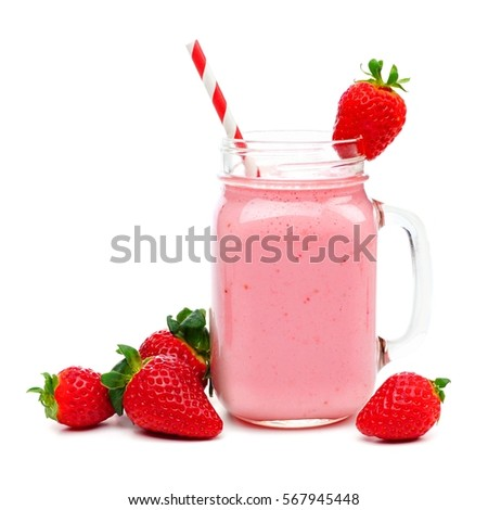 Pink strawberry smoothie in a mason jar glass with straw and scattered berries isolated on white