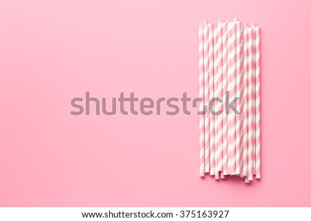 pink striped straws on pink background