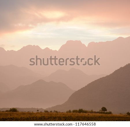 pink sunrise on the mountains ranges around Shkodra, Albania - stock photo