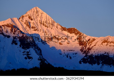 Pink Sunset on Snowy Wilson Peak.  The San Juan Range, Rocky Mountains, Colorado. - stock photo