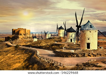 pink sunset over Cosuegra windmills - stock photo
