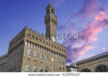 pink sunset over Palazzo Vecchio in Florence, Italy