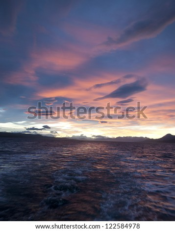 Pink sunset over the ocean in the Beagle Channel.