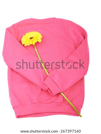 Pink sweater with yellow  flower isolated on white background - stock photo