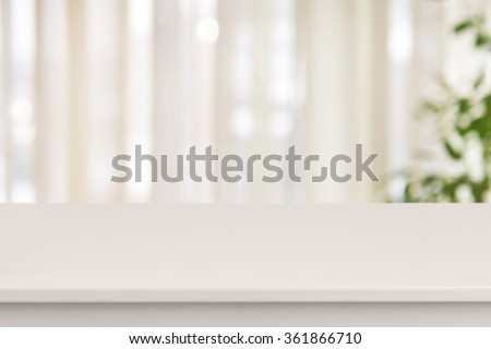 Pink table on defocuced window with curtain background - stock photo