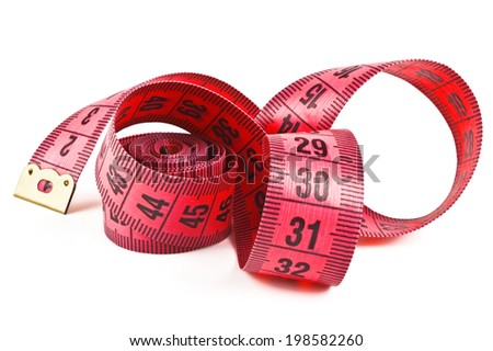 pink tape measure twisted spiral on white background - stock photo