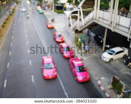 Pink taxi motion and queue at sky train station in Thailand. - stock photo