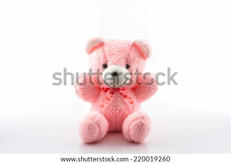 Pink teddy bear on white background. - stock photo