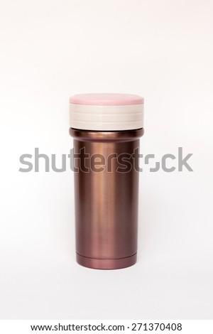 Pink thermos travel tumbler - stock photo